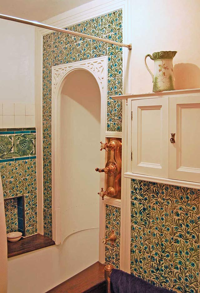 Shower and bath with wall to ceiling De Morgan tudor rose tile