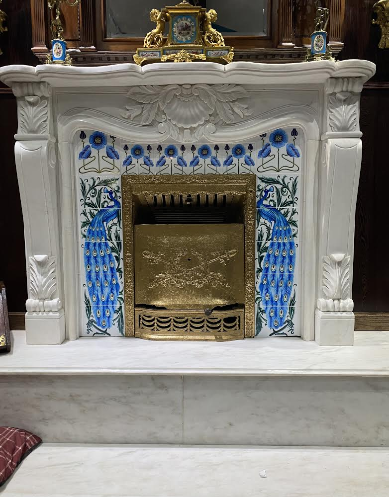 De Morgan fireplace surround with early Art Nouveau turquoise peacocks