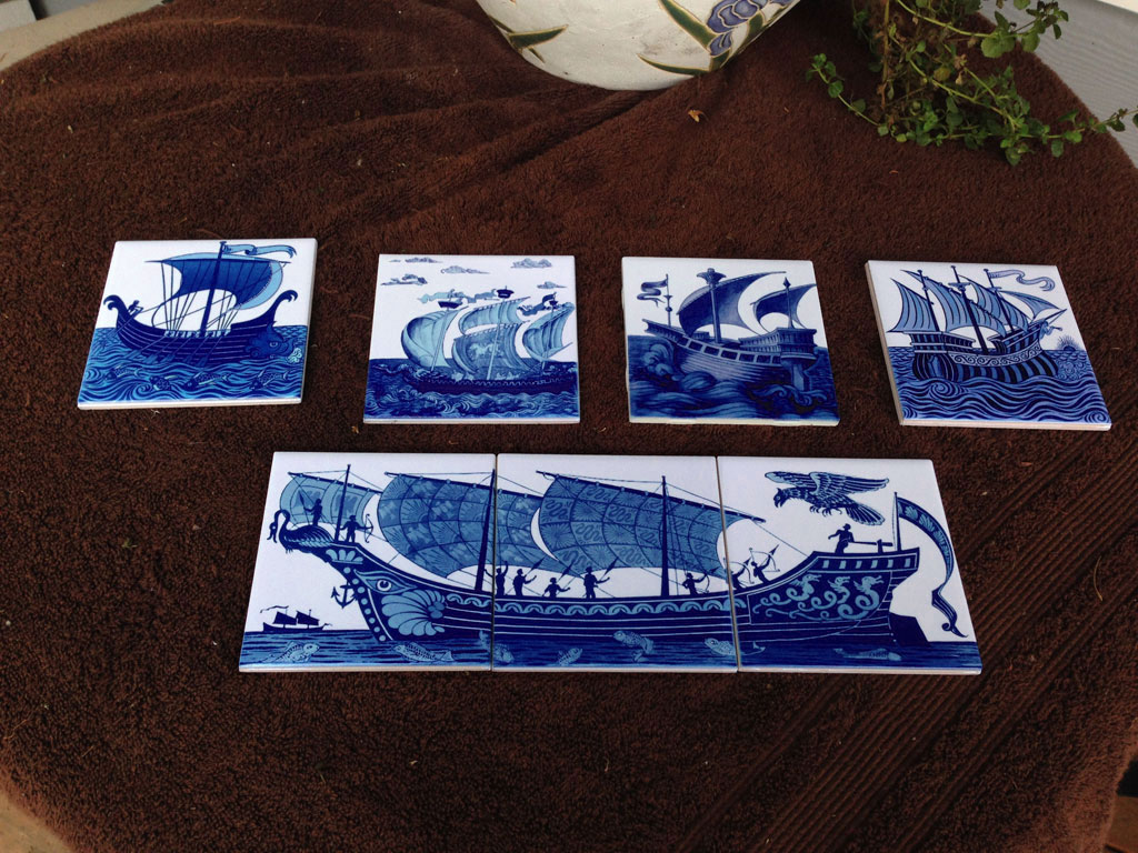 De Morgan ships in 4.25 inch tiles. From top left: longship with rowers, dragon lead ship, galleon, angel and rising sun, archers and magic bird