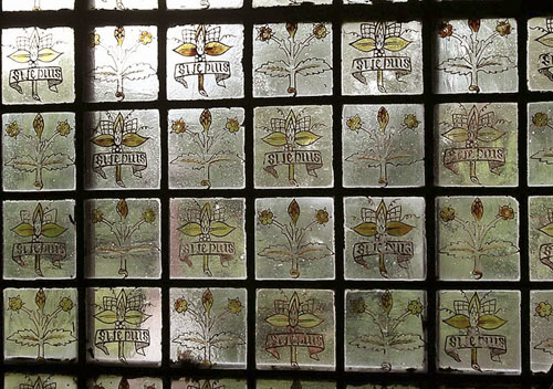 Stained glass window at Red House with Morris's motto: Si Je Puis