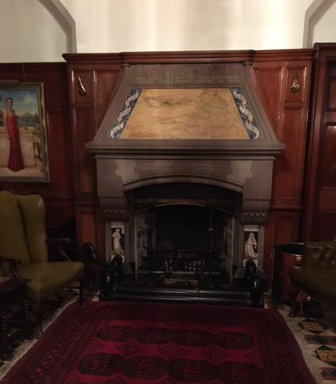 Tromode (Cronkbourne) House hallway fireplace, with William Morris Cinderella side panels
