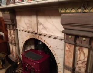 Tromode House library fireplace, after removal of Beauty and the Beast tile panels