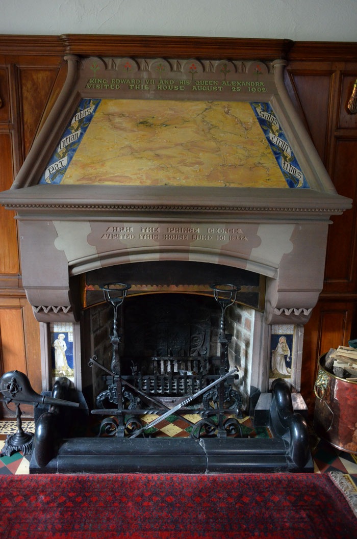 Tromode (Cronkbourne) House hallway fireplace, with William Morris Cinderella side panels