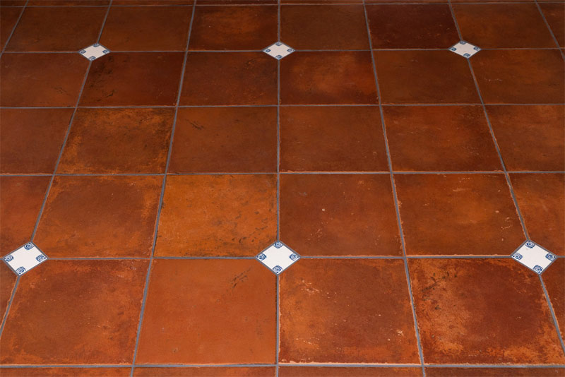 Philip Webb whorls inlaid in Saltillo tiles