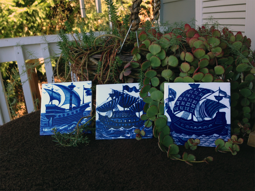 De Morgan ship tiles in cobalt and white. From left: Merton Abby galleon, Man o'War, Armada flagship.