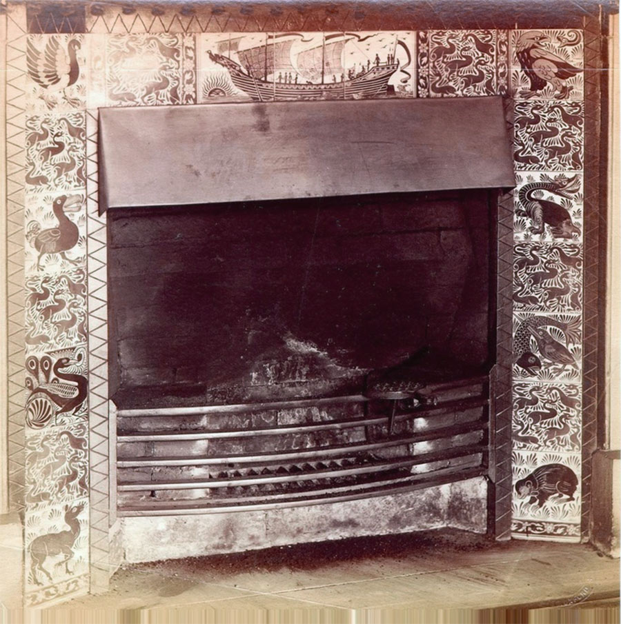 Lewis Carroll's fireplace showing a mix of William De Morgan Ship Tryptich and Fanastic Animal Tiles