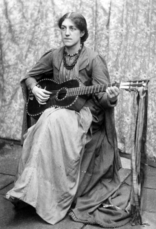 May Morris, 1890s, playing a guitar