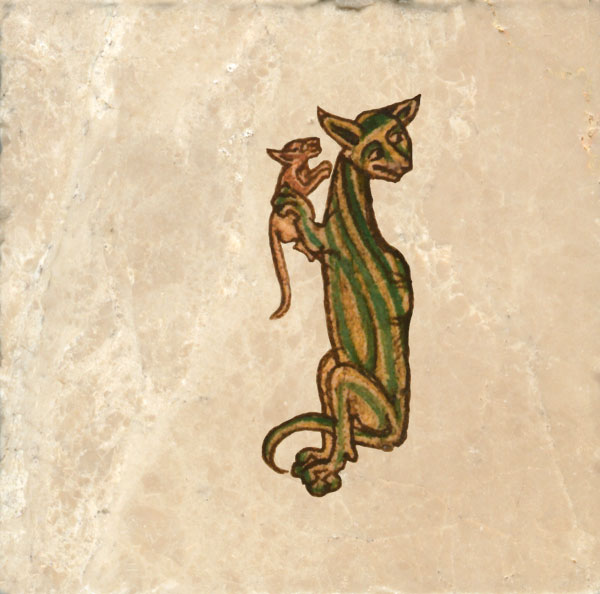Cat with green stripes having just caught a mouse