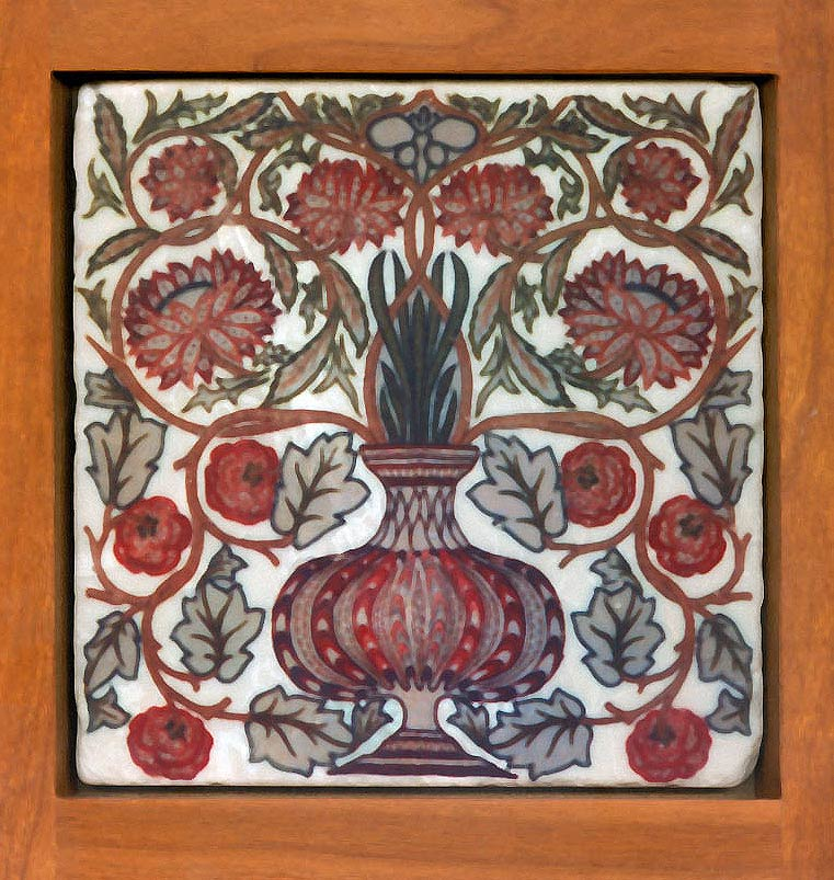 May Morris flowerpot tile, six-inch. May Morris, William Morris's younger daughter, was an amazing woman, not only for her time but for any time.  By the time she was 23, she was the director of the embroidery department at Morris & Co. This is a design for an embroidered pillow implemented on tumbled marble. David Eklund frame. WilliamMorrisTile.com