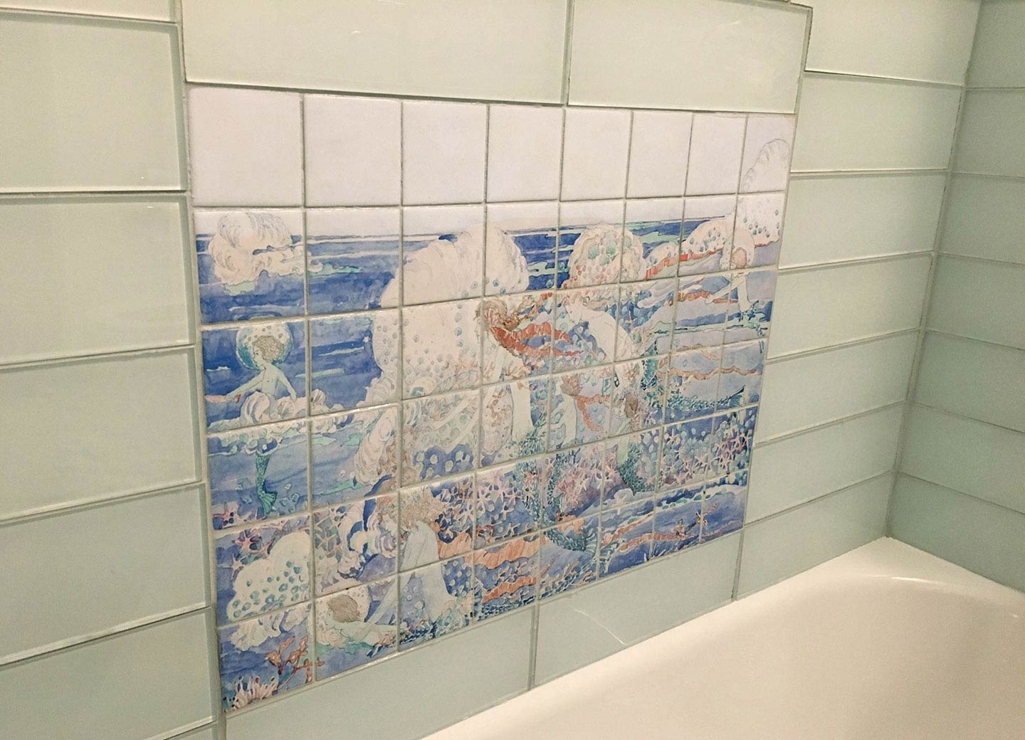 Mermaid backsplash installed in bath